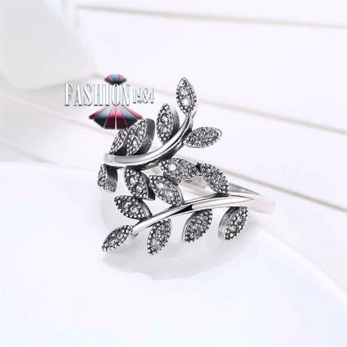 טבעת כסף מעוצבת בצורת עלי זית ומשובצת זירקון